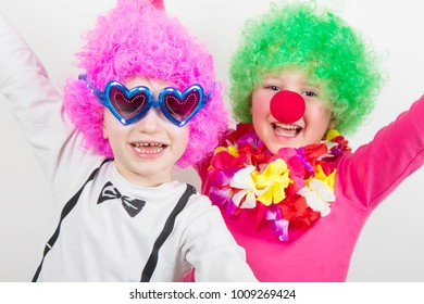 couple of child wearing clowns object for carnival