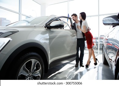 couple chooses the car. Attractive couple chooses a car