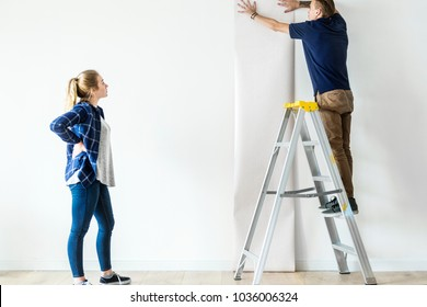 Couple choosing house wallpaper