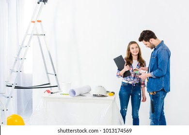 couple choosing palette for painting walls