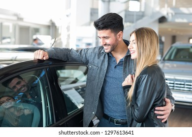 Couple choosing their new car