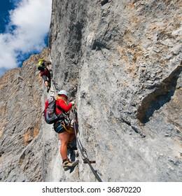 couple climbing mountain