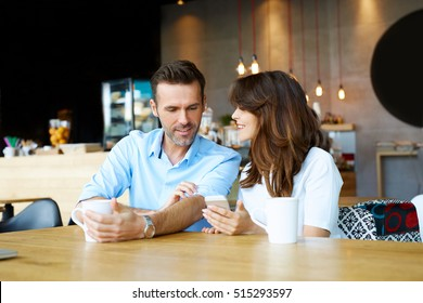 Couple at coffee shop spending time together