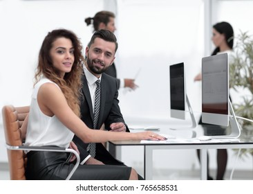 couple of colleagues sitting at a Desk
