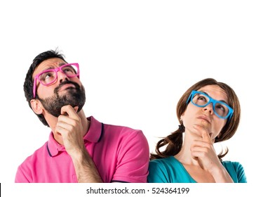 Couple in colorful clothes thinking something