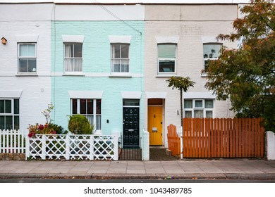 a couple of colorful houses side by side