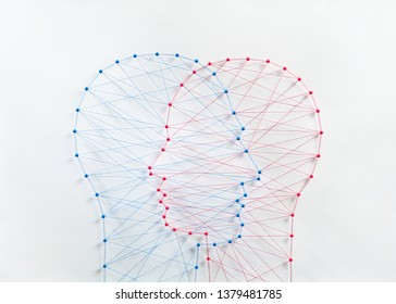 Couple community concept. Network of pins and threads in the shape of two heads mearging symbolising a deep connection relationship.