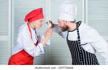 Couple compete in culinary arts. Who cook better. Culinary battle concept. Woman and bearded man culinary show competitors. Ultimate cooking challenge. Culinary battle of two chefs. Kitchen rules.