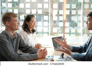 couple consulting lawyer about buying renting house car. insurance broker financial advisor giving legal advice to customer.realtor selling real estate property to client