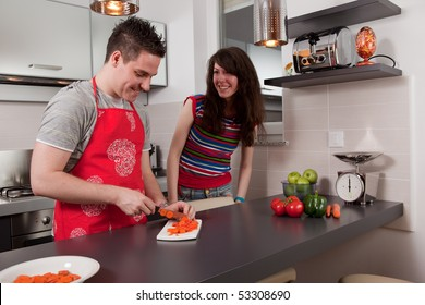 Couple cooking and having fun together in kitchen.