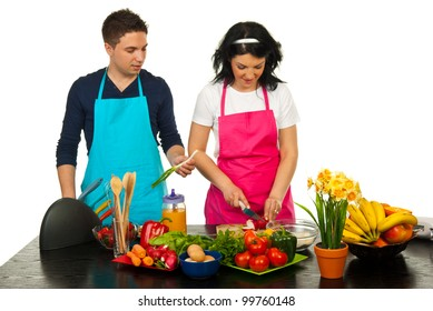 Couple cooking together in kitchen against white  background