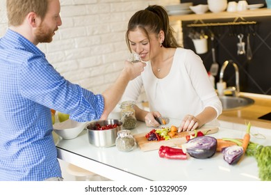 Couple cooking together in the modern kitchen at home