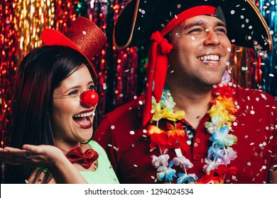Couple in costume celebrating the carnival party in Brazil