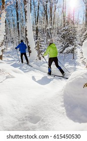 A couple cross country skis in fresh snow in canada