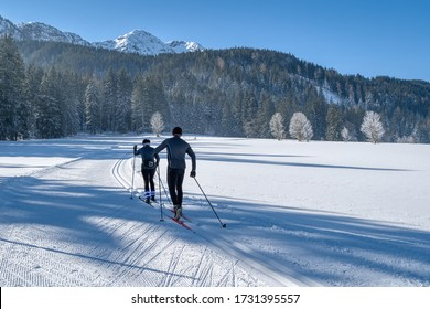 Couple cross-country skiing in beautiful nordic winter landscape in Leogang, Tirol, Alps, Austria