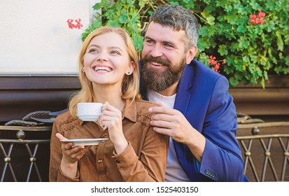 Couple cuddling cafe terrace. Couple in love sit hug cafe terrace enjoy coffee. Pleasant family weekend. Explore cafe and public places. Married lovely couple relaxing together. Happy together.