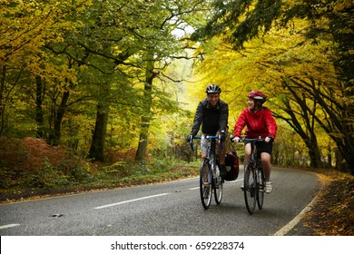 Couple cycling along country road