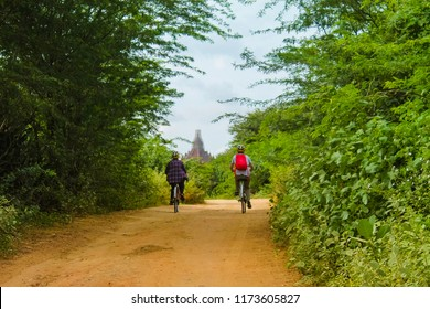 Couple cycling around the fields in Bagan - Exploring the amazing temples in Bagan, Myanmar