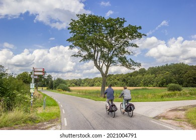 Couple cycling in the nature reserve of Balloerveld in Drenthe, Netherlands