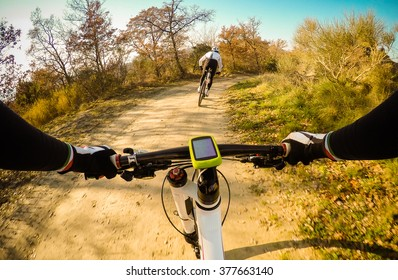 Couple of Cyclist during a mountain bike race. Pov, Original Point of View.
