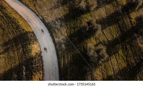 Couple of cyclists in the countryside. Bird eye view. Drone photograpy
