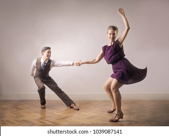 Couple of dancers having a lot of fun