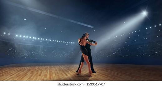 Couple dancers  perform latin dance on professional arena. Ballroom dancing.