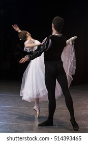 A couple dancing ballet at the stage