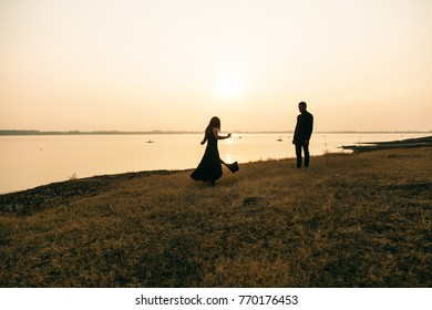 couple dancing by the water