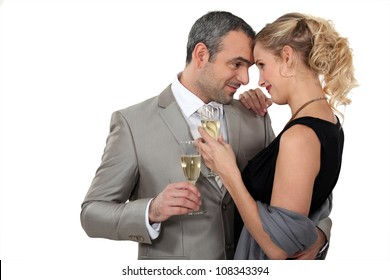 Couple dancing with glasses of champagne