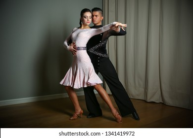 7d8e53a1d1a6 couple dancing Latin dances. man and woman show the movement of the dance  Rumba.