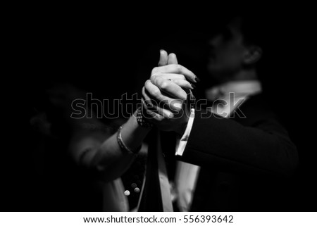couple dancing on a dark background