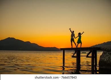 Couple dancing salsa at sunset. Couple dancing on tropical beach. Vacation, travel, tourism, honeymoon, life, dream. Dreaming concept. Sensual. Fashion photo. Honeymoon. Adventure. Romantic lovers.