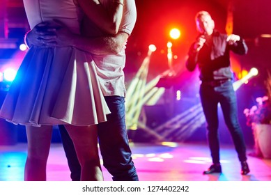 couple dancing slow dance in a nightclub