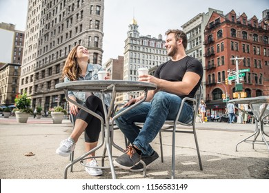 Couple dating in a coffeehouse bar in Manhattan - Tourists talking and having fun while sighseeing New York