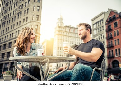 Couple dating in a coffeehouse bar in Manhattan - Tourists talking and having fun while sightseeing New York