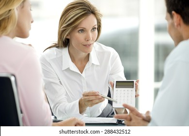 Couple dealing with a financial adviser at the bank