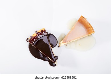 Couple of Delicious Lemon Flavor Cheesecake with chocolate sauce isolated on white background. Top View
