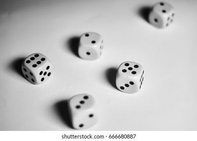 A couple of dices scattered across a white background