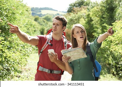 Couple Disagreeing About Best Way To Navigate On Hike
