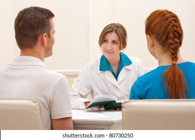 Couple discussing with female doctor sexologist