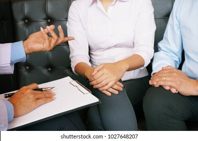 Couple Discussing Problems with Psychiatrist and Relationship Counselor