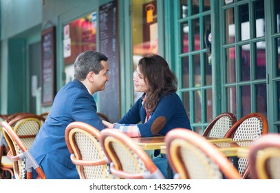 Couple discussing something in an outdoor restaurant