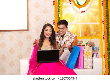 Couple Diwali Festival Celebration & Shopping. Enjoying Diwali Festival at home.