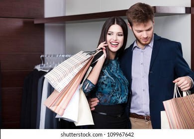 Couple does shopping at the sale shop with great variety of clothes