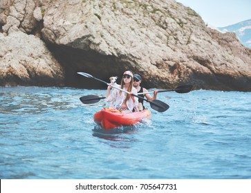 couple with dog walking by sea canoe. family witn pet in vacation