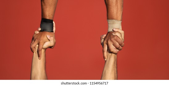 Couple doing acro yoga exercises close up of hands