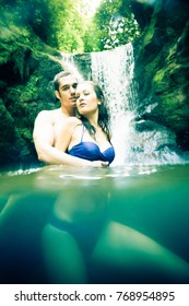 Couple Doing Embracing Under Waterfall
