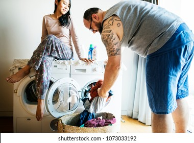 Couple doing a laundry