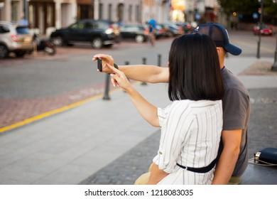 couple doing selfie in the street